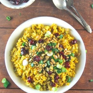 Pumpkin Biryani topped with candied cranberries and pumpkin seeds. A vegan and gluten-free recipe.