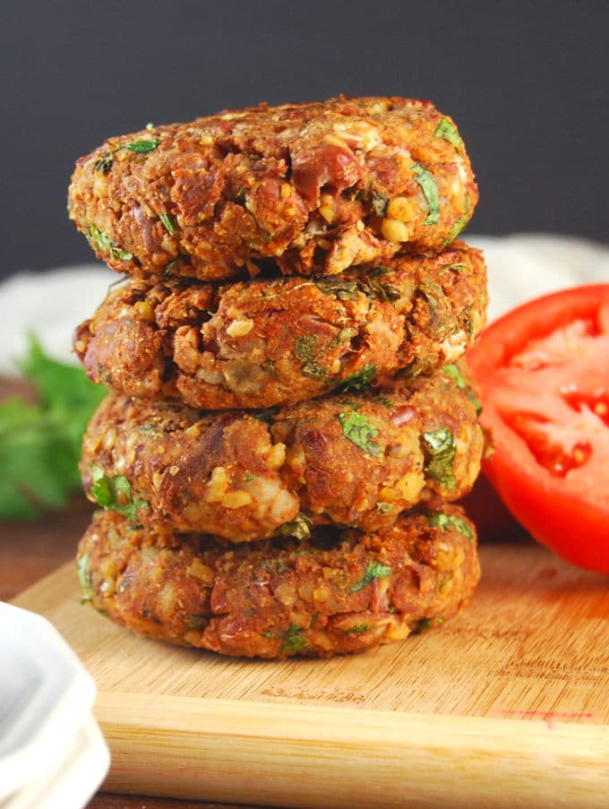 Stack of Tandoori Naan Burger patties on a chopping board.