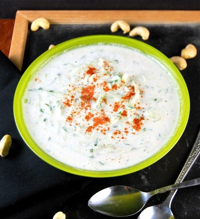 Vegan Cucumber Raita in a green bowl.
