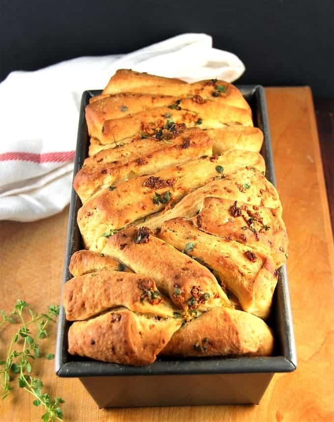 A vegan garlic pull apart bread in loaf pan.