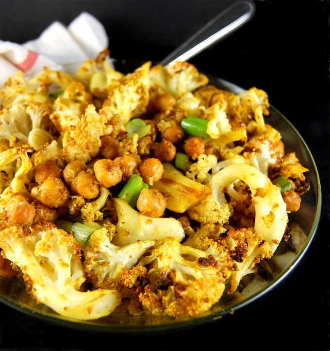 A bowl of roasted Cauliflower and Chickpeas with Indian Spices. Vegan, gluten-free, nut-free, soy-free.