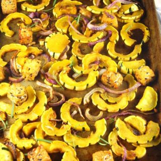 Roasted delicata squash with tempeh, onions and curry spices