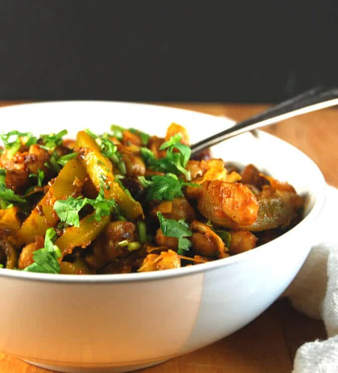 Spicy Sour Smashed Chickpeas in blue and white bowl