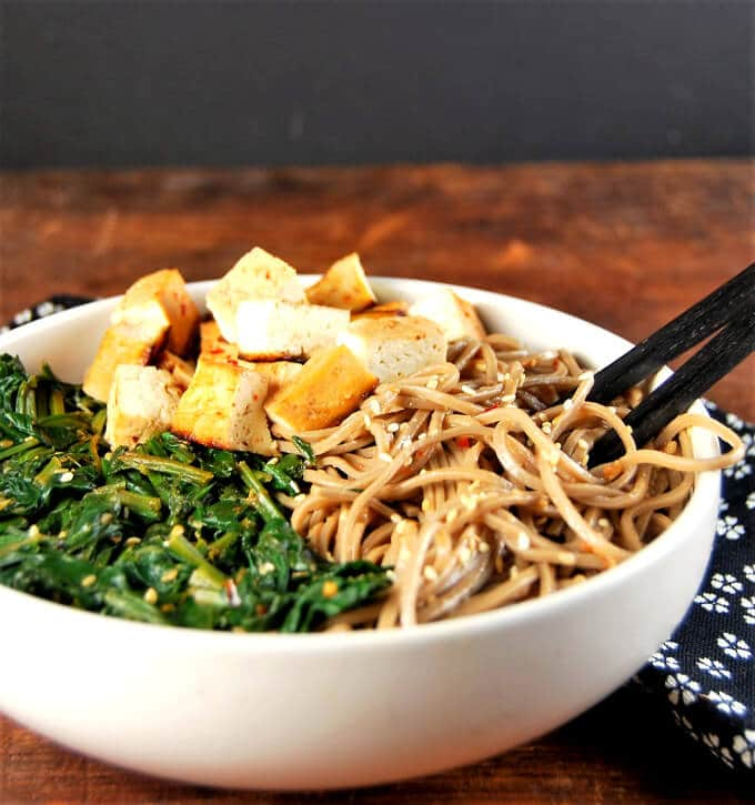 Healthy Sesame soba noodle bowl with spinach and tofu