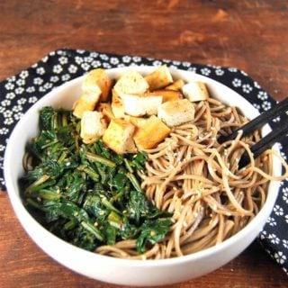 Sesame soba noodle bowl with spinach and tofu