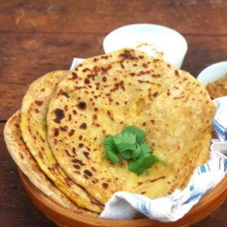 An easy recipe for Aloo Paratha with tips on how to roll them. A great lunchbox option. Vegan.