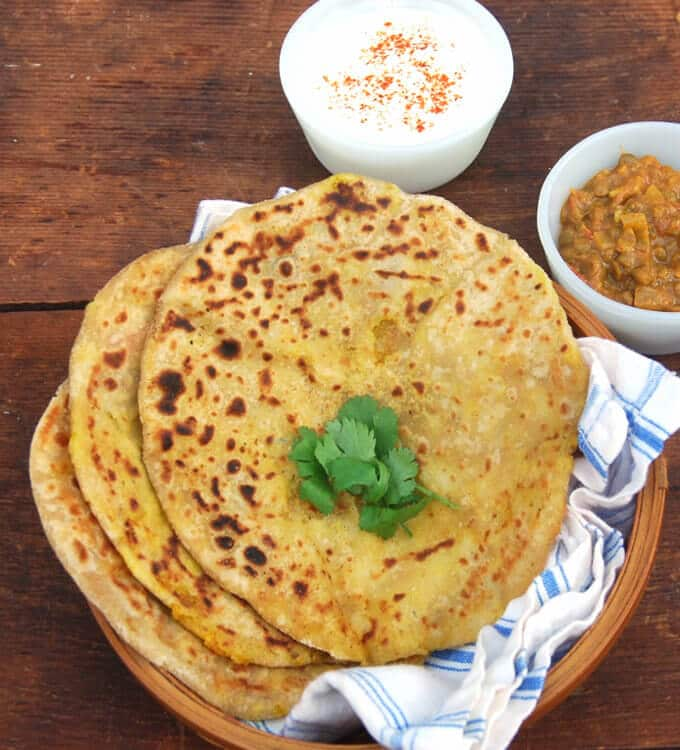 An easy Aloo Paratha with tips on how to roll the parathas. A great lunchbox option. Vegan.