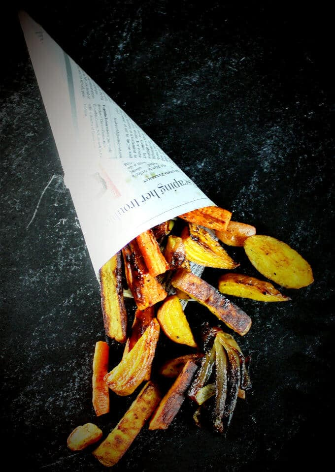 Turmeric Roasted Root Vegetables in a paper cone.
