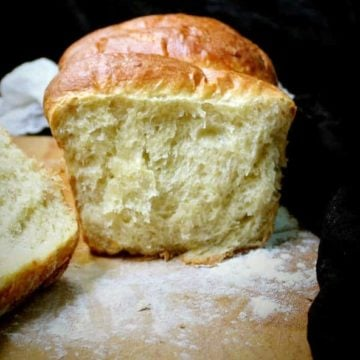 In this delicious, tender vegan olive oil brioche, aquafaba stands in for the eggs. The texture is light, feathery, and with a tight crumb, exactly the way a brioche is meant to be. #vegan, #brioche, #frenchbread | HolyCowVegan.net