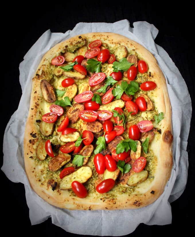 Pizza with roasted fingerling potatoes and cherry tomatoes