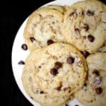 Close up of vegan chocolate chip cookies on a white plate