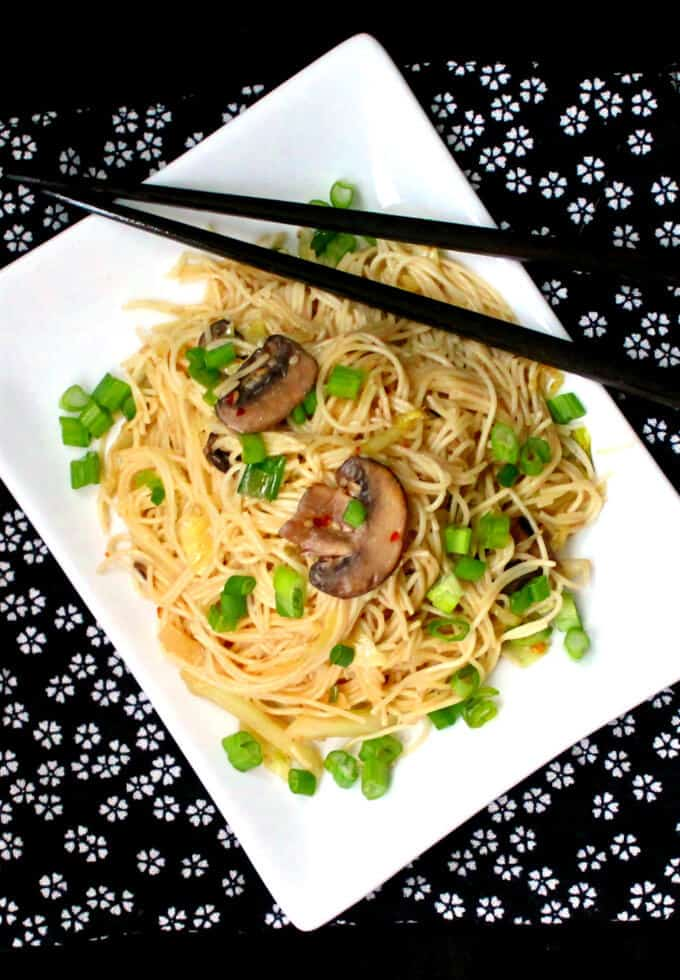 Vegan Chinese Longevity Noodles piled high with scallions, mushrooms, and ginger - HolyCowVegan.net