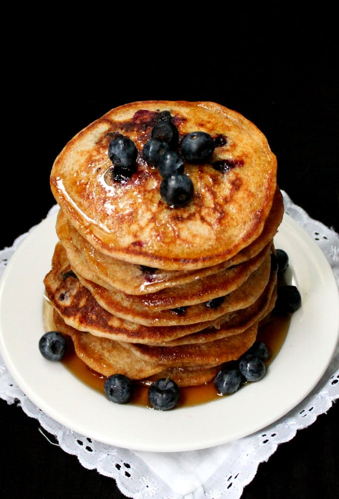 Golden brown Vegan Sourdough Blueberry Pancakes, perfectly cooked with blueberries and maple syrup - HolyCowVegan.net