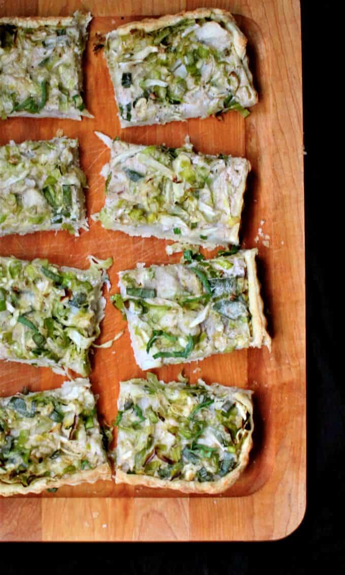 Slices of vegan Irish potato tart on a chopping board.