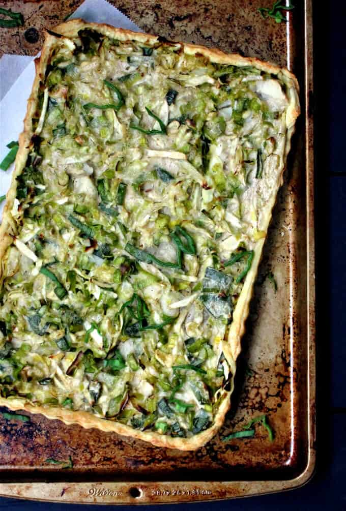 Overhead shot of a vegan Irish style cabbage, leek and potato tart with all the flavors of colcannon in golden, crispy puff pastry.