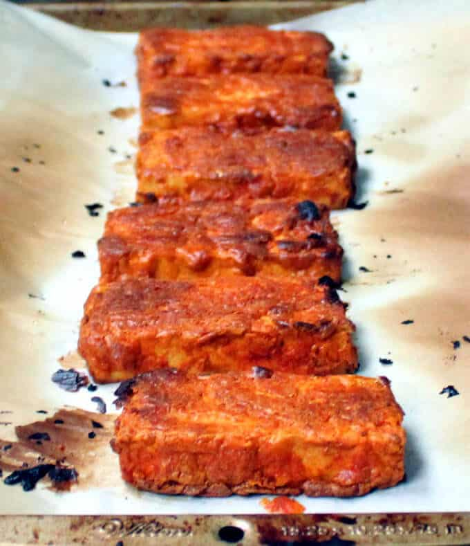 Oven Blackened Tandoori Tofu on parchment paper on a baking sheet - HolyCowVegan.net
