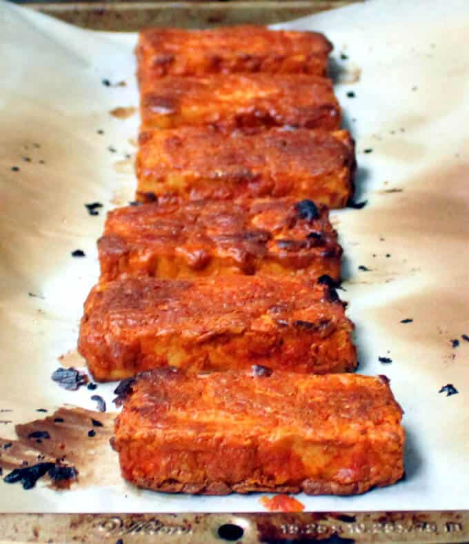 Photo of Oven Blackened Tandoori Tofu on parchment paper on a baking sheet