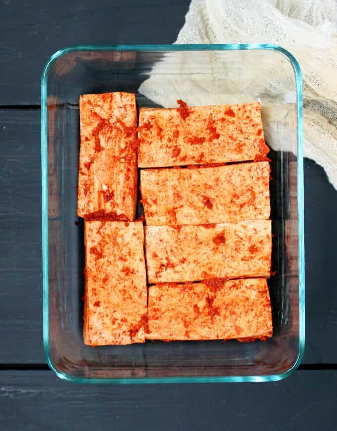 Tofu slathered with a marinade of paprika, ginger, garlic and salt for tandoori tofu