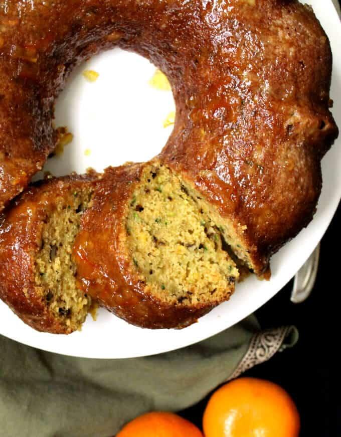 Closeup photo of sliced vegan zucchini cake showing shreds of zucchini in soft, moist crumb.