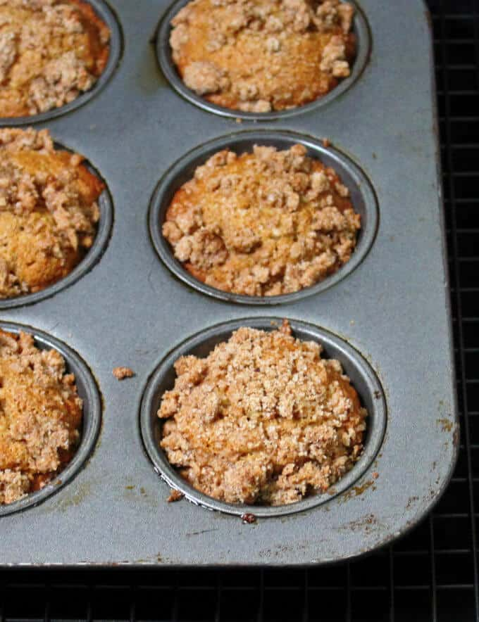 Vegan Banana Crumb Muffins in a muffin tin with streusel on top