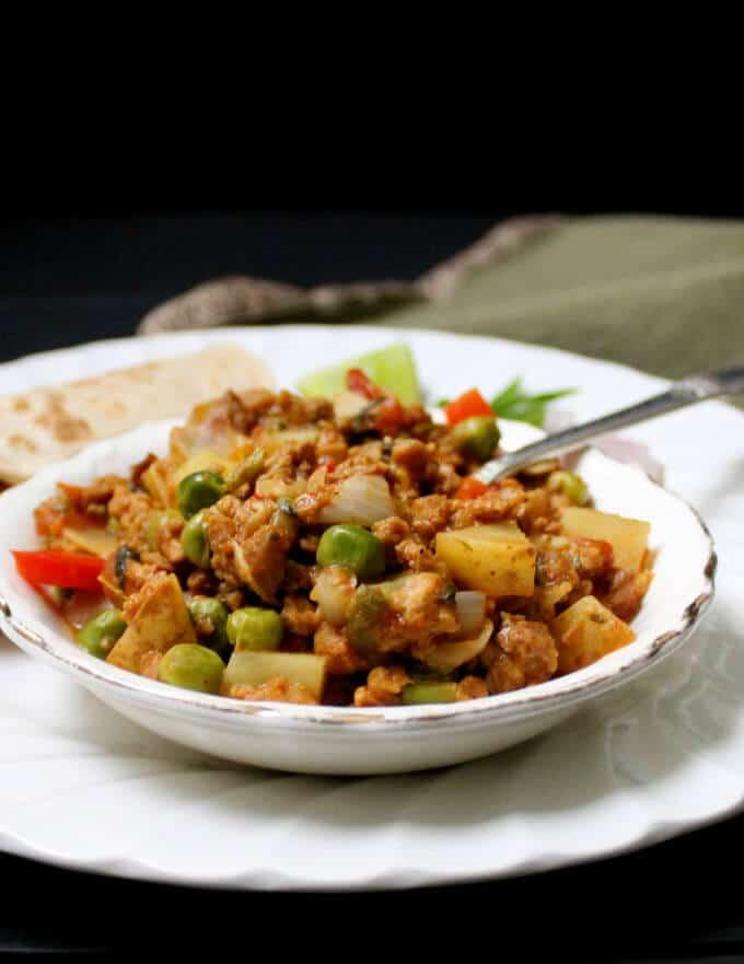 Vegan keema masala in a bowl with spoon.