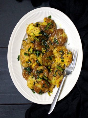 Smashed Potato Salad with Turmeric and Curry Leaves Dressing #turmeric #vegan #soyfree #glutenfree #nutfree #potatoes #sidedish #salad HolyCowVegan.net