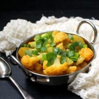 This Cauliflower Curry with Potatoes is a beautiful way to showcase this versatile Fall vegetable. Indian spices add depth and flavor, and tons of deliciousness. Serve with rice, roti or bread. A vegan, soy-free, gluten-free and nut-free recipe. #vegan #soyfree #nutfree #glutenfree #cauliflower #indian #curry HolyCowVegan.net