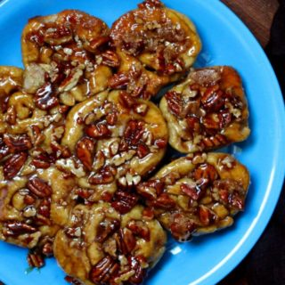 These vegan Sourdough Sticky Buns make a delicious breakfast or dessert, and bonus, you can make it with your discard or unfed starter. They are gooey, sticky, crusted with caramel-coated pecans, and absolutely scrumptious. A soy-free recipe. #vegan #soyfree #breakfast HolyCowVegan.net