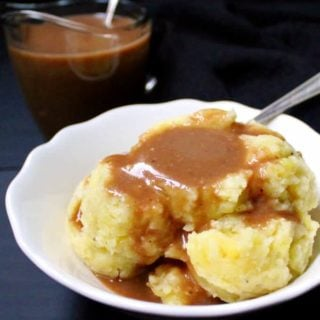 This vegan Mushroom Gravy is thick, creamy, rich and it enhances just about any dish you pour it over, from mashed potatoes to meatballs to a meatless loaf. At your Thanksgiving table, it's sure to become a star. Vegan, nut-free, can be gluten-free. #vegan #thanksgiving #mushrooms #gravy #nutfree HolyCowVegan.net