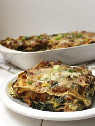 A creamy Vegan Sausage Breakfast Lasagna is the perfect start to a day. It's layered with veggies like spinach, leeks and scallions, and all of this goodness is smothered in a dreamy bechamel sauce.#vegan #breakfast #lasagna HolyCowVegan.net