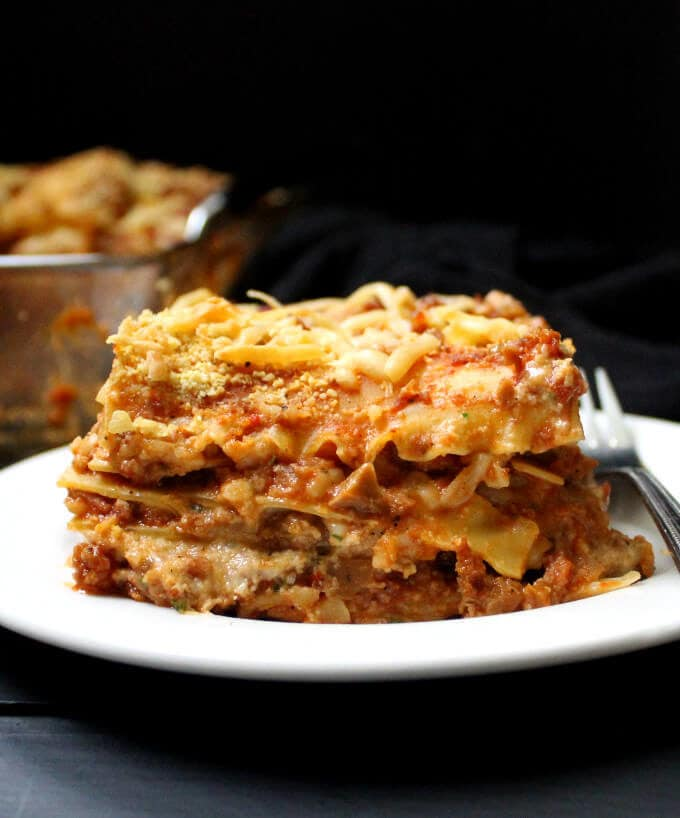 "A classic lasagna recipe with a meatfree ""meat"" sauce and vegan ricotta, parmesan and mozzarella cheeses. Perfect comfort food for a crowd or for a cozy dinner in with family or friends. #vegan #lasagna #thanksgiving #recipes #holidays #italianfood #pasta HolyCowVegan.net"