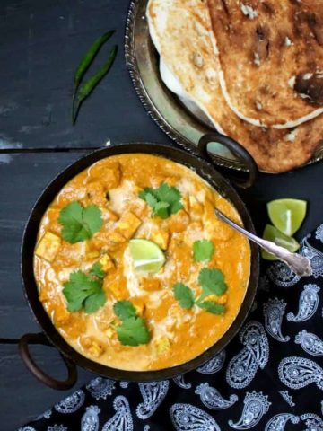 Vegan Butter Chicken with Tofu, a creamy, orange gravy with all six tastes of Ayurveda, with flavorful cubes of tofu. #vegan #tofu #curry #butterchicken #dinner #ayurveda HolyCowVegan.net