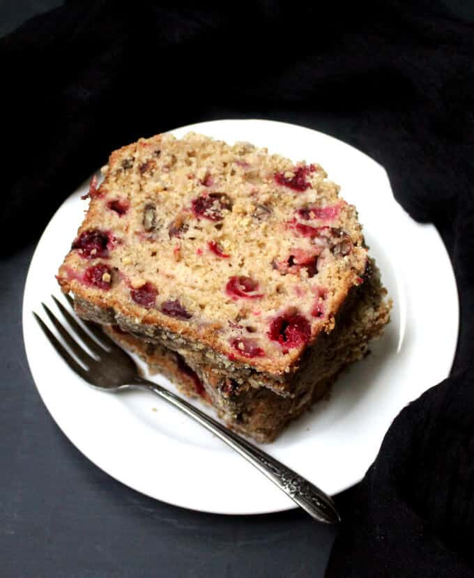 A vegan Cranberry Breakfast Bread is the perfect way to start a holiday with family and friends. The tender crumb has tiny bursts of tart, juicy cranberries and nutty pecans. A vegan, soy-free and nut-free recipe.#vegan #soyfree #nutfree #thanksgiving #recipe HolyCowVegan.net