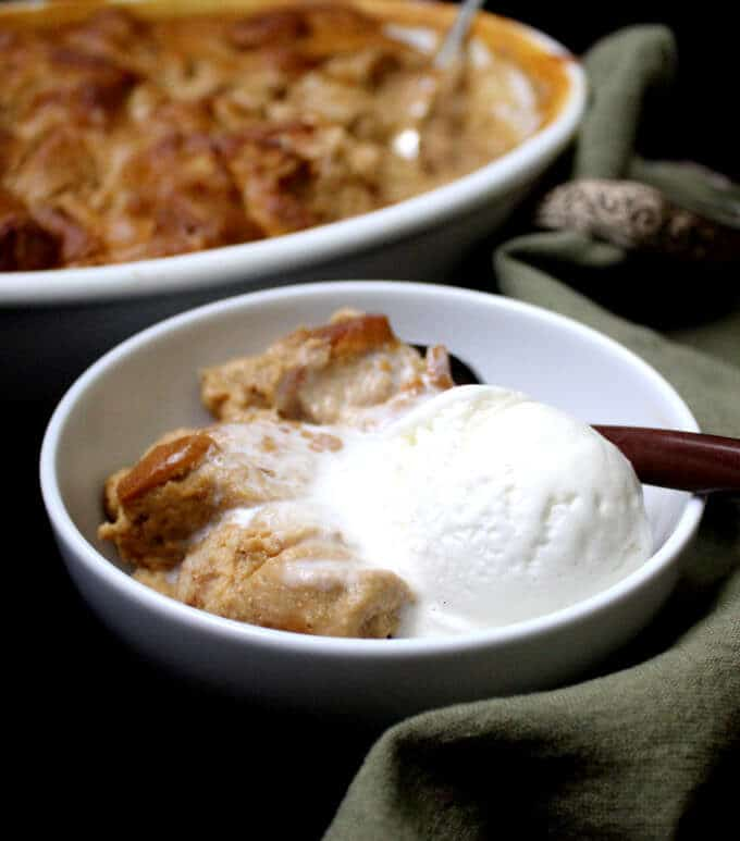Any time is a good time for this delicious Vegan Pumpkin Bread Pudding made with wholegrain bread. Cinnamon, ginger, nutmeg and cloves add a festive touch. This recipe can be made with gluten-free bread. #vegan #thanksgiving #pumpkin #pudding #breakfast #dessert HolyCowVegan.net