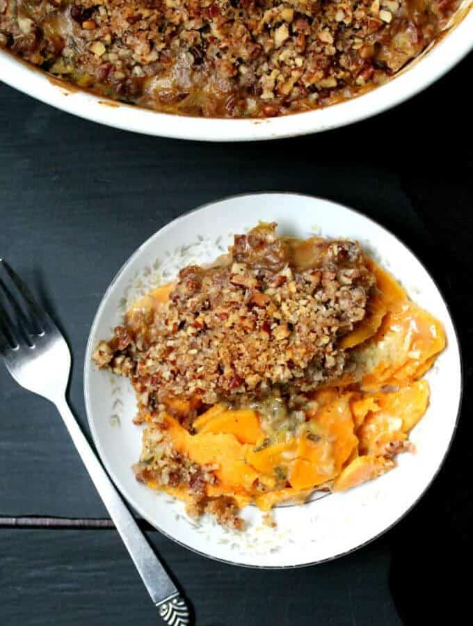 Scalloped Sweet Potatoes with Crunchy Pecan Topping are the perfect holiday side. It's a delicious recipe that's also gorgeous to look at. Vegan, soy-free and can be gluten-free and nut-free. #vegan #side #recipes #thanksgiving #sweetpotatoes #holidays #soyfree HolyCowVegan.net