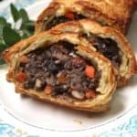 This gorgeous Vegan Wellington with Mushrooms and Lentils will have everyone gawking -- and gorging -- at your holiday table. It tastes just as good as it looks, with meaty lentils and mushrooms tied together by a mirepoix of onions, carrots and celery and infused with fresh herbs. A vegan, nut-free recipe. #vegan #thanksgiving #holidayrecipes #nutfree #kidfriendly HolyCowVegan.net