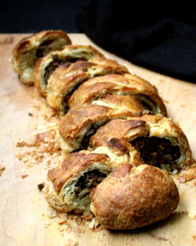 Slices of Vegan Wellington with Mushrooms and Lentils on a chopping board