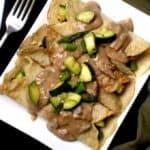Savory Vegan Crepes with Mushroom Sauce and a light filling of veggies. Vegan recipe. #vegan #breakfast #crepe #recipe HolyCowVegan.net