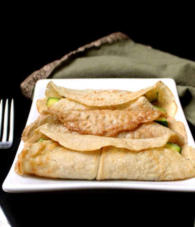 Savory Vegan Crepes with Mushroom Sauce and a light filling of veggies. Vegan recipe. #vegan #breakfast #crepe #recipe HolyCowVegan.net