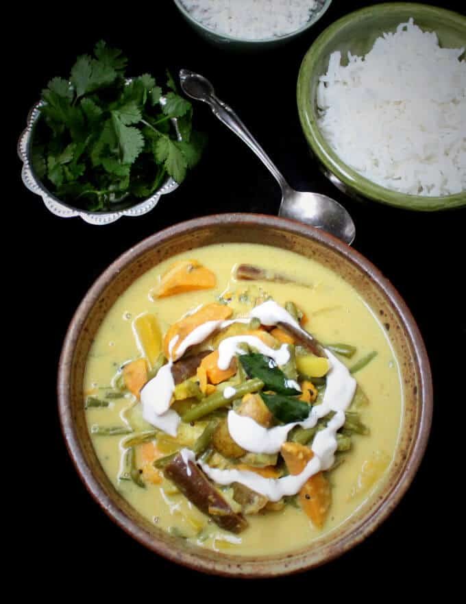 Overhead photo of aviyal or south Indian veg curry in a bowl.