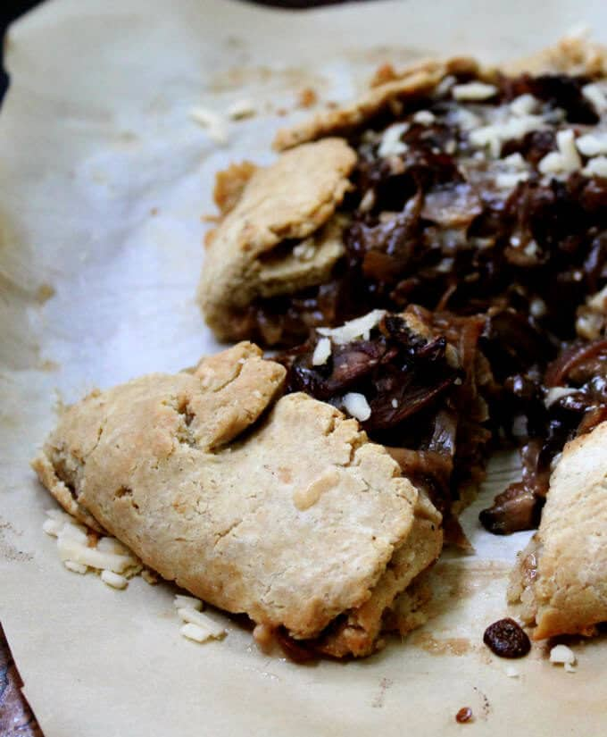 Savory Gluten-free and vegan Caramelized Onion and Mushroom Galette with a flaky, golden, gluten-free and vegan crust that'll blow your mind. #vegan, #glutenfree, #soyfree, #nutfree, #dinner HolyCowVegan.net