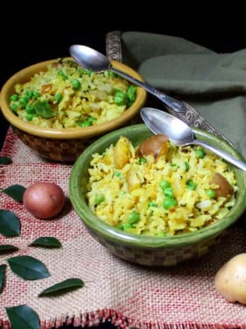Flattened Rice with Potatoes, Onions and Peas, or Kande Pohe, are a classic Indian breakfast. They are healthy, delicious, gluten-free, soy-free, nut-free and divinely vegan. #vegan #soyfree #nutfree #glutenfree #breakfast #indian #recipe HolyCowVegan.net