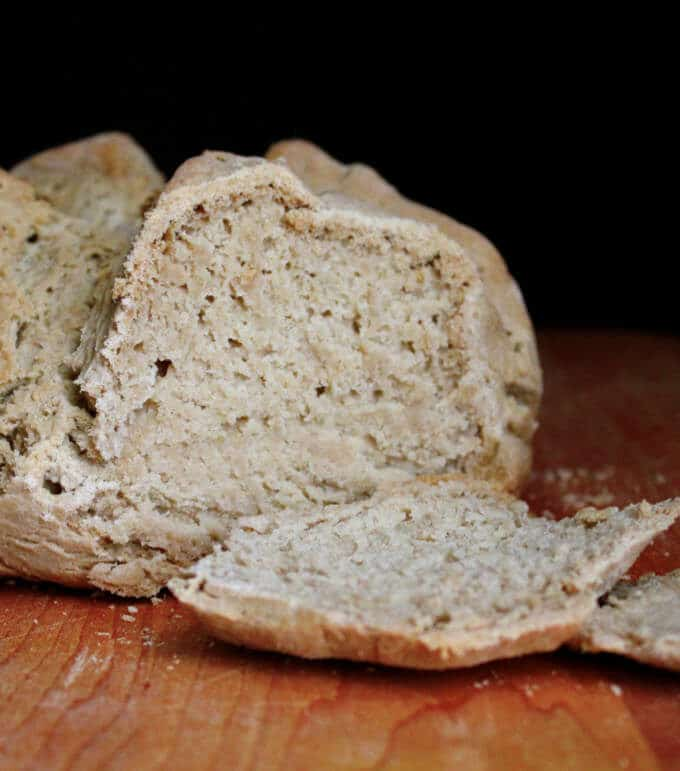 This vegan gluten-free Irish Soda Bread is as classic and traditional as this bread can get, only with a modern, healthy twist. The bread has a dense texture, a soft and tender crumb, and there's nothing quite as delicious as a warm, hot-off-the-oven slice slathered with vegan butter. #stpatricksday #irishrecipe #vegan #bread #irish #breakfast #glutenfree HolyCowVegan.net