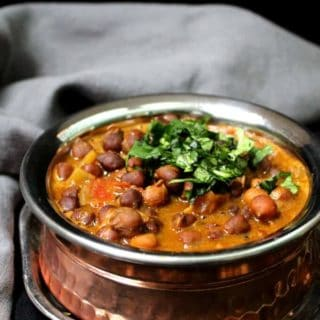 A delicious and instant Chana Masala that comes together in less time that it'd take you to pick up the phone and order takeout. #vegan #glutenfree #Indianfood #onepot HolyCowVegan.net