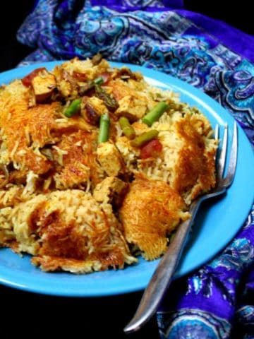 Persian Rice with Asparagus. The rice is golden, delicious, fragrant and infinitely appetizing! Asparagus adds a fresh, seasonal flavor. #vegan, #glutenfree, #rice, #persian, #saffron, #asparagus. Can be soy-free. HolyCowVegan.net