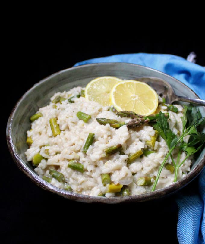 Creamy and delicious, this Vegan Asparagus Risotto is heaven in a bowl! #vegan, #glutenfree, #soyfree, #healthy, #dinnerrecipe HolyCowVegan.net