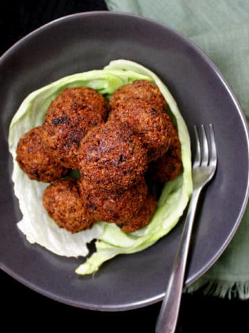 A mountain of perfectly cooked, golden falafel. #vegan #soyfree #glutenfree #nutfree #snack HolyCowVegan.net