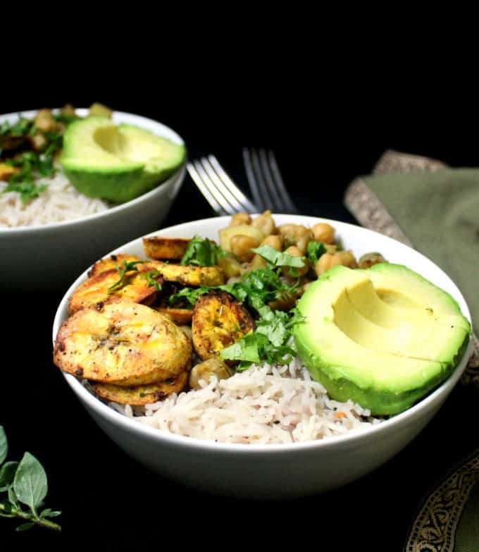 A delicious Caribbean Bowl with Coconut Rice, Chickpea Curry and Roasted Plantains
