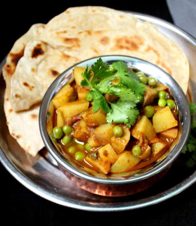 Close up shot of aloo matar in a handi bowl