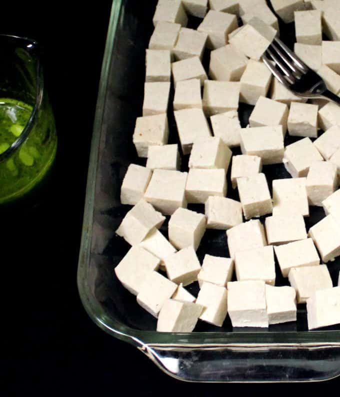 Tofu cubes in a baking tray